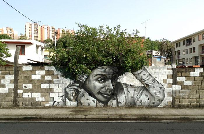 street art uomo che si pettina cespuglio di capelli